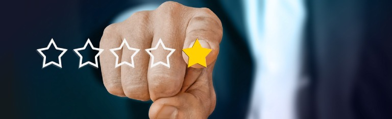 Man's finger selecting a one-star review rating